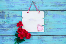 Blank White Wood Sign With Pink Hearts And Red Roses Hanging On Rustic Teal Blue Wood Door