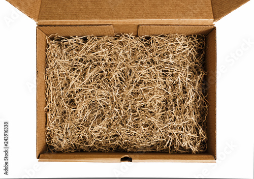 Fényképezés  Brown shredded paper for gifting and stuffing in cardboard box
