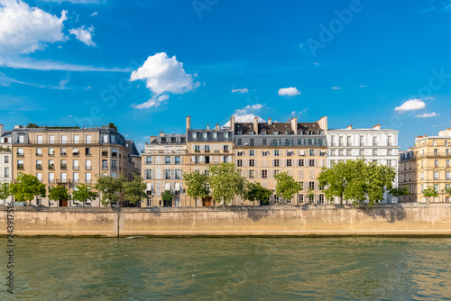 Paris, view of ile saint-louis and quai d'Orleans, beautiful buildings and quays in summer