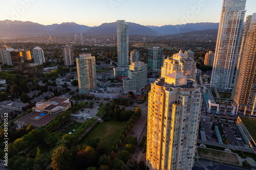 Aerial view of a modern city during a vibrant sunset. Taken in Metrotown, Burnaby, Vancouver, BC, Canada.