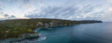 Aerial Panoramic Canadian Landscape View By The Atlantic Ocean Coast During A Cloudy Sunrise. Taken In Beachside, Newfoundland, Canada.
