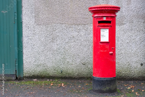 Red pillar post box for mail collection Wallpaper Mural