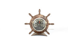 Old Brown Barometer In The Form Of The Ship Steering Wheel Rudder Isolated On A White Background