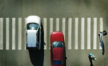 Aerial. Two Cars On A Pedestri...