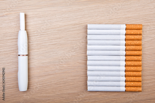 electronic smoke device cigarette wooden table nobody - Buy this