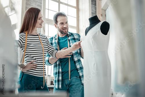 Vászonkép  Fashion designer feeling satisfied after designing amazing dress