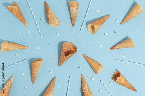 Fotografie, Obraz  Waffle cones for ice cream on a blue background. Top view.