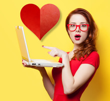 Surprised Redhead Girl With Laptop And Abstract Heart Shape On Yellow Background. In Love Concept Of Blind Date