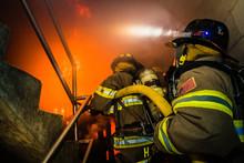 Firefighter Training Inside A Burning Building