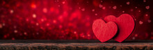 Two Red Valentine's Hearts Standing On Wooden Table With Soft Romantic Background