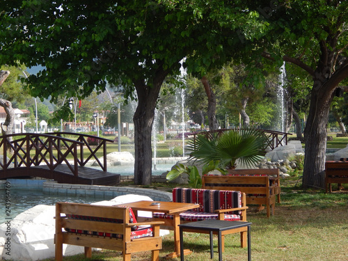 Fototapeta table and chairs in the seaside park obraz na płótnie