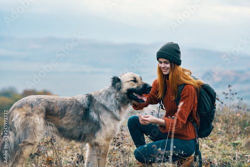 happy woman with dog on nature Wallpaper Mural