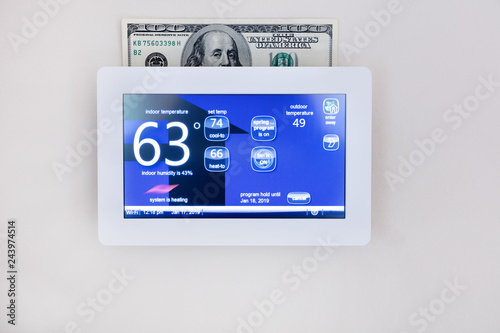 Fotografie, Obraz  digital thermostat technology to heat or cool home for energy savings concept