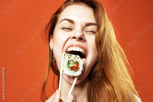Fotografija woman eating rolls portrait asia