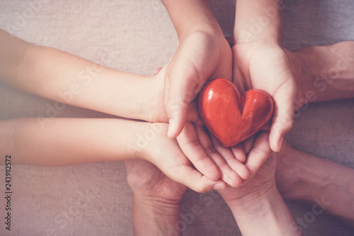 Photo  hands holding red heart, health insurance, donation concept