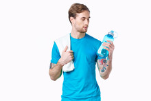 Athlete Man With A Towel On His Shoulder On An Isolated Background Bottle Of Water