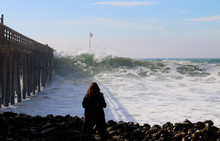 Woman Looking At Giant Wave