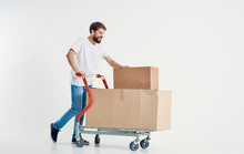 Man Carries A Cart With Boxes Moving