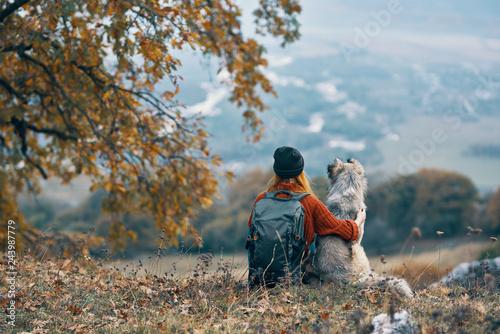 Photo  woman with dog nature autumn mountains trip