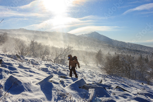 Winter hiking in the mountains on a sunny windy day Poster Mural XXL