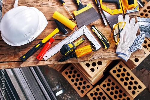 Obraz Home repairs. Construction tools, bricks and helmet top view - fototapety do salonu