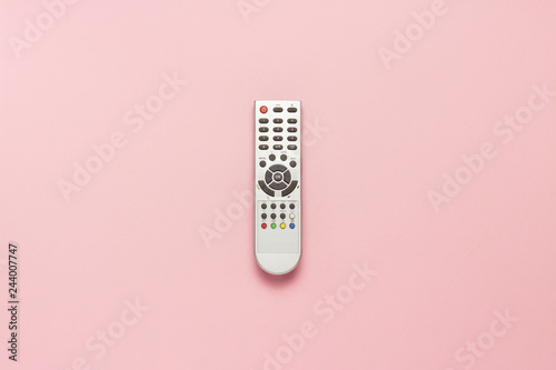 Fotografia  Gray remote control on a pink background