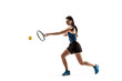 Full length portrait of young woman playing tennis isolated on white background. Healthy lifestyle. The practicing, fitness, sport, exercise concept. The female model in motion or movement