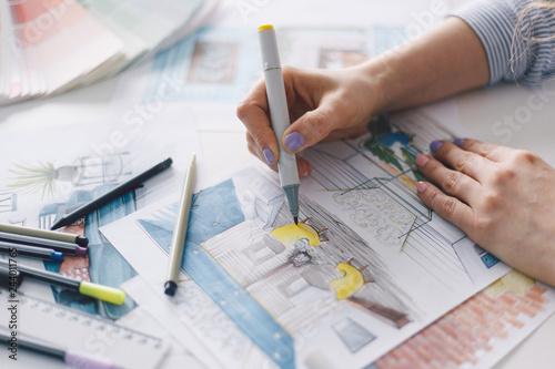 Fotografie, Obraz  Hand of designer working with illustration sketch of home interior with marker