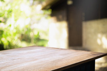 Empty Wood Table With Blur Montage Outdoor Garden Background