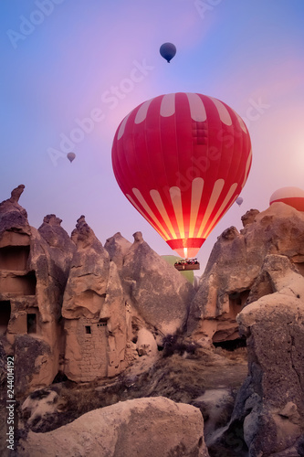 Beautiful hot air balloons flying over Cappadocia landscape at sunrise Canvas Print