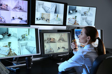 Security Guard Monitoring Modern CCTV Cameras In Surveillance Room