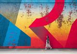 Fototapeta Młodzieżowe - Young girl on the background of graffiti