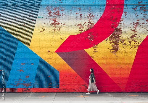 Young girl on the background of graffiti
