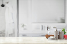 Gray Ceramic Bottle With White Cotton Towels In Basket On Marble Counter Over Bathroom Background