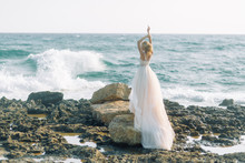 Bride On The Beach In Cyprus. Sunset Photo Shoot Of A Beautiful Girl.
