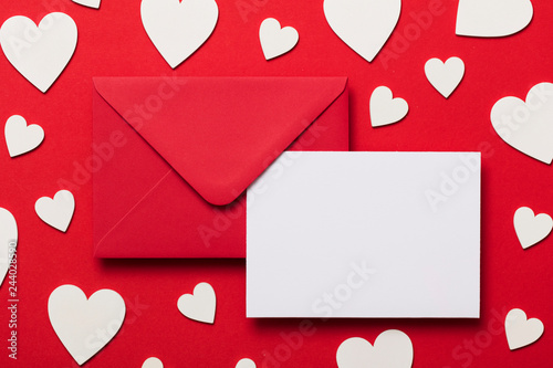 Valentine's day love letter mockup. Red envelope blank white card and hearts
