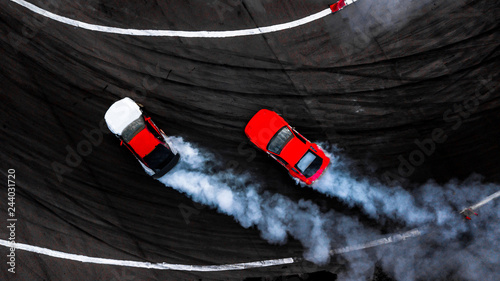 Car drift battle on abstract black texture and background tire skid mark, Two car drifting battle on race track with smoke, Aerial view automobile and automotive Fototapete