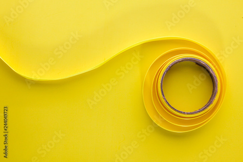 Yellow  ribbon on yellow background table top