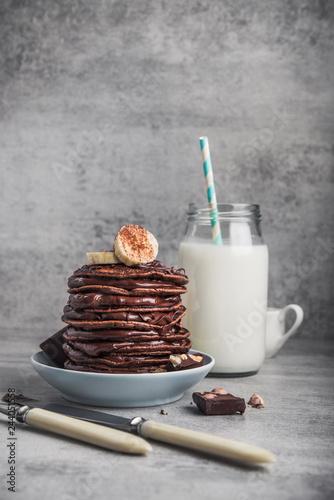 In de dag Milkshake Tasty pancake with chocolate, banana and milk bottle