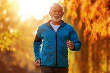 Senior Man Running In The Park