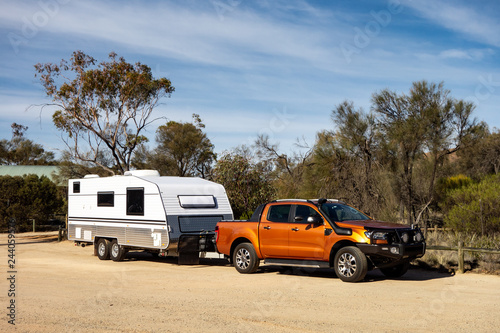 Fényképezés Off road pickup car with air intakes and a white caravan trailer in Western Aust