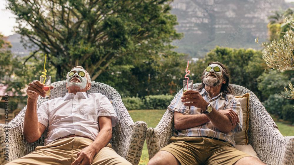 Fototapeta Retired friends enjoying facial spa treatment