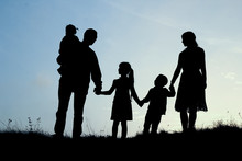 Silhouette Of A Happy Family W...