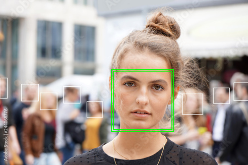 Fotografía  young woman picked out by face detection or facial recognition software - severa