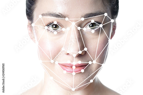 Photo  face detection or facial recognition grid overlay on face of young beautiful wom