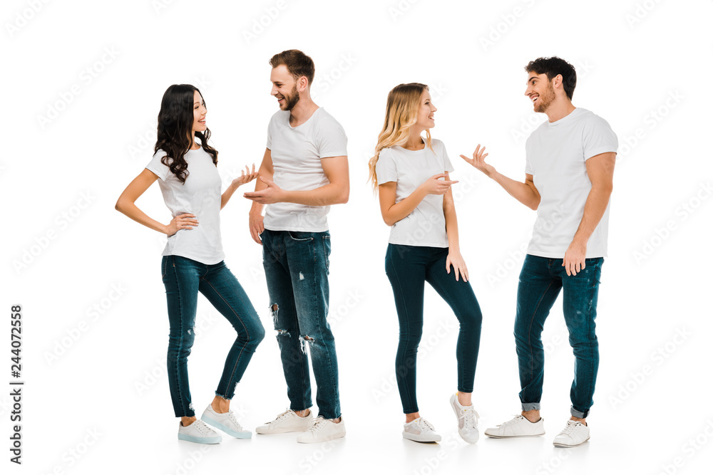 Fototapeta full length view of young couples standing and talking isolated on white
