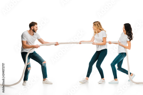 Fotomural emotional young man and women pulling rope isolated on white