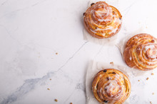 Cinnamon Rolls Buns On A White Marble Background. Bakery Concept. Breakfast And Brunch. Flatlay. Overhead. Copy Space