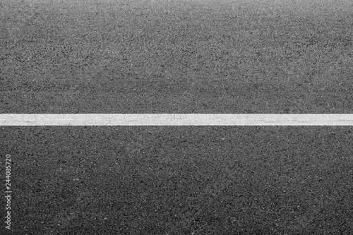 Fotografiet  New asphalt texture with white dashed line