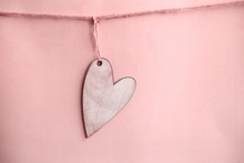 Wooden Heart On Pink Background